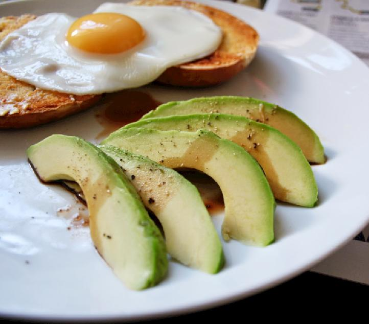 avocado and egg Five Reasons To Eat Eggs Everyday