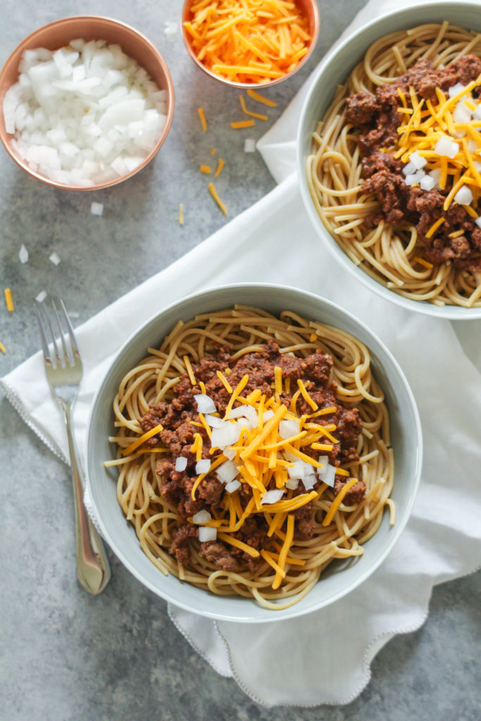 Famous in the Midwest, Cincinnati Chili is a Mediterranean spiced meat sauce used as a topping for spaghetti and garnished with cheddar cheese and white onion.