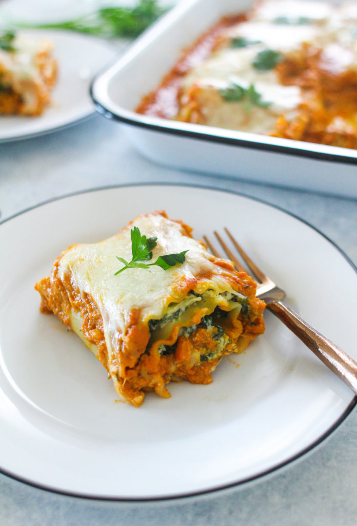 Creamy and cheesy pumpkin sauce is the highlight of this dish! Kick off the pumpkin season with these delicious pumpkin lasagna rolls stuffed with sauteed kale and onions.