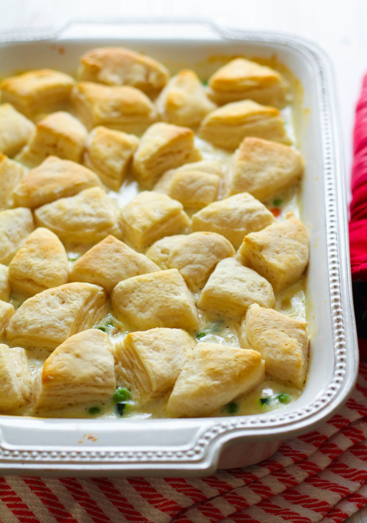 Warm up with one of my family's favorite dishes: chicken pot pie! Flaky, golden biscuit pieces top a savory chicken and veggie filling, including carrots, potatoes, sweet peas zucchini. All baked in a creamy and smooth white sauce.
