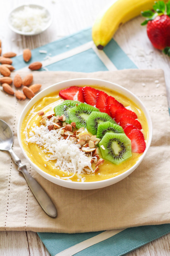 Indulge in the taste of the tropics any time of the year with this tropical smoothie bowl! The addition of turmeric adds anti-inflammatory power, while the fruit and toppings provide plenty of fiber, vitamins and minerals, and anti-oxidants!