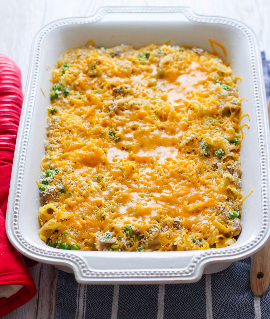 Simple and creamy, this tuna noodle casserole is sure to fix those comfort-food cravings! Filled with white button mushrooms and plenty of petite green peas, this veggie packed casserole makes a perfect weeknight dinner.