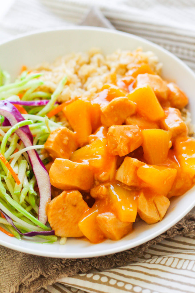 Instant Pot Sweet and Sour Chicken with Pineapple is sure to be a huge hit! Moist, tender chicken pieces are covered with a tangy sweet n' sour sauce, paired with pineapple, brown rice and an Asian broccoli slaw.