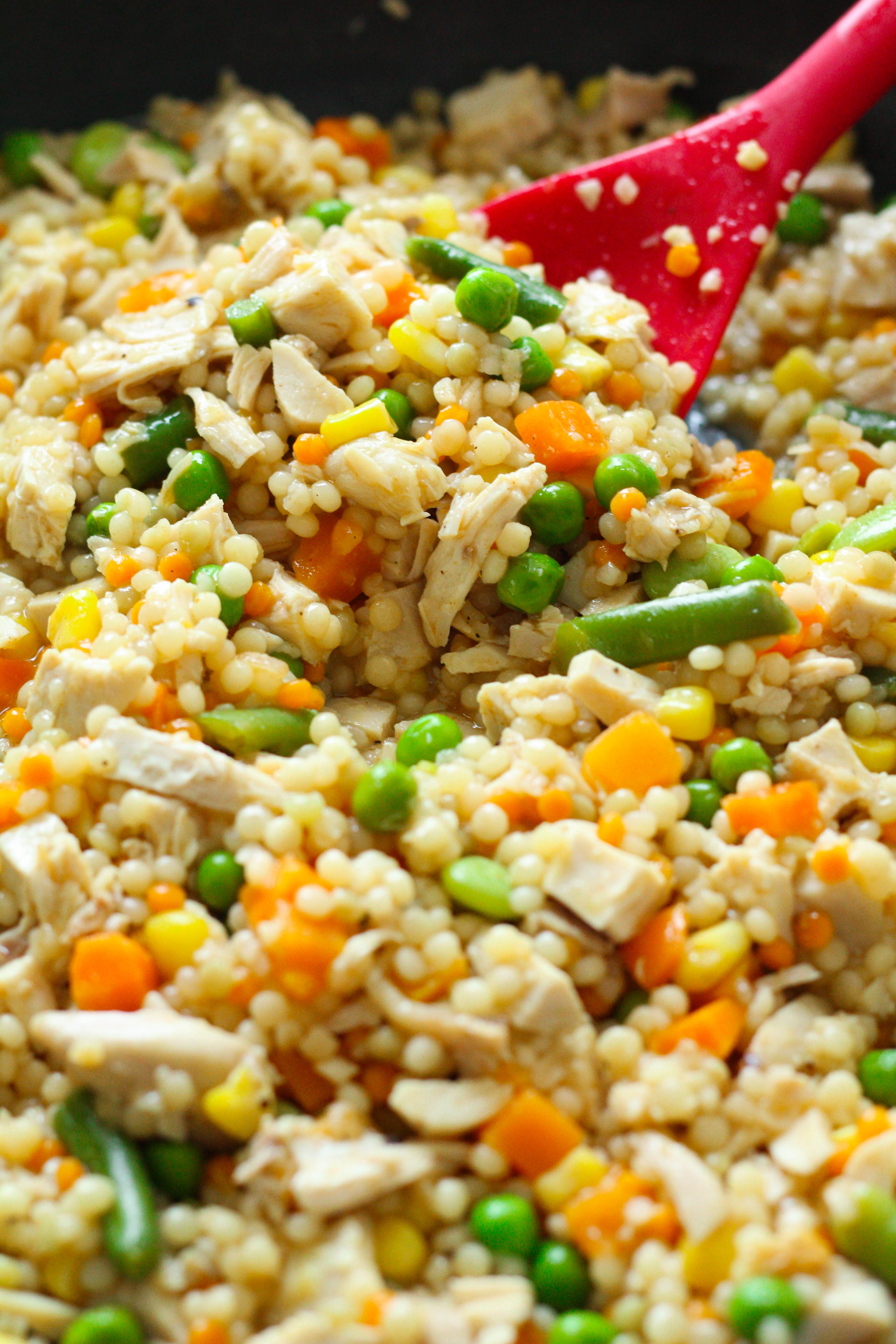 Pearled couscous chicken, simmered in broth with mixed veggies. An easy, delicious dinner that can be ready in less than 15 minutes.