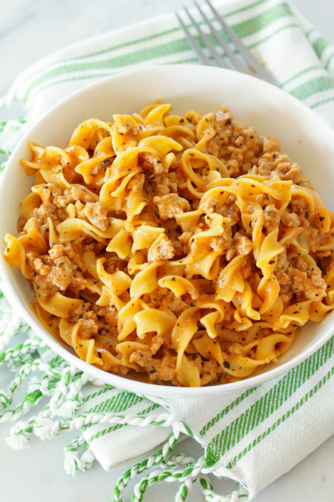 This delicious ONE POT cheesy turkey pasta dinner is sure to please the whole family! Ground turkey is combined with Italian spices, milk and cheddar cheese to create a tasty pasta dish!