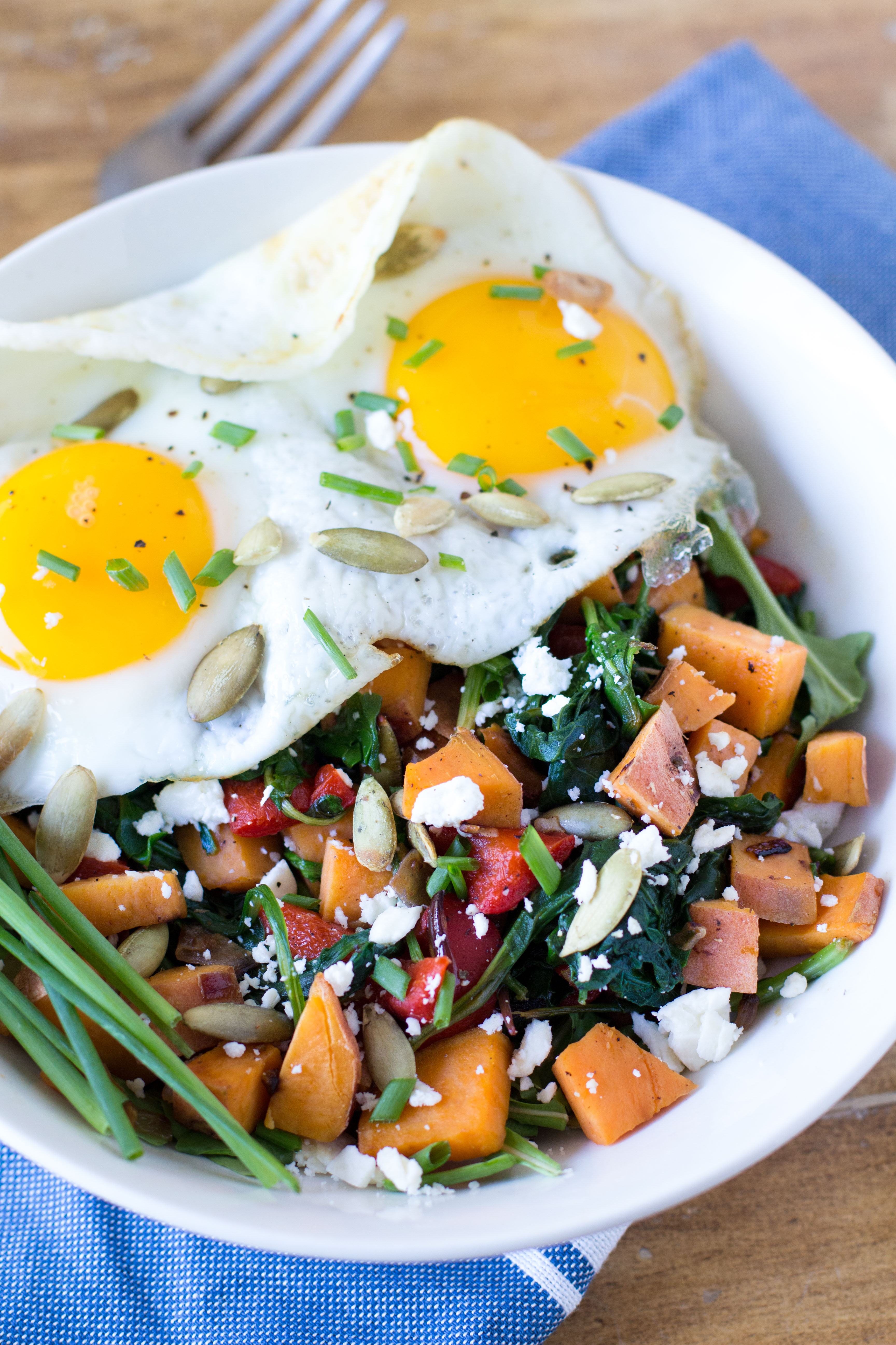 Start your day with a filling and nutritious breakfast bowl! Sweet potatoes, power greens, red pepper and onion add tons of fiber and vitamins, while fried eggs provide protein to keep you full until your next meal.