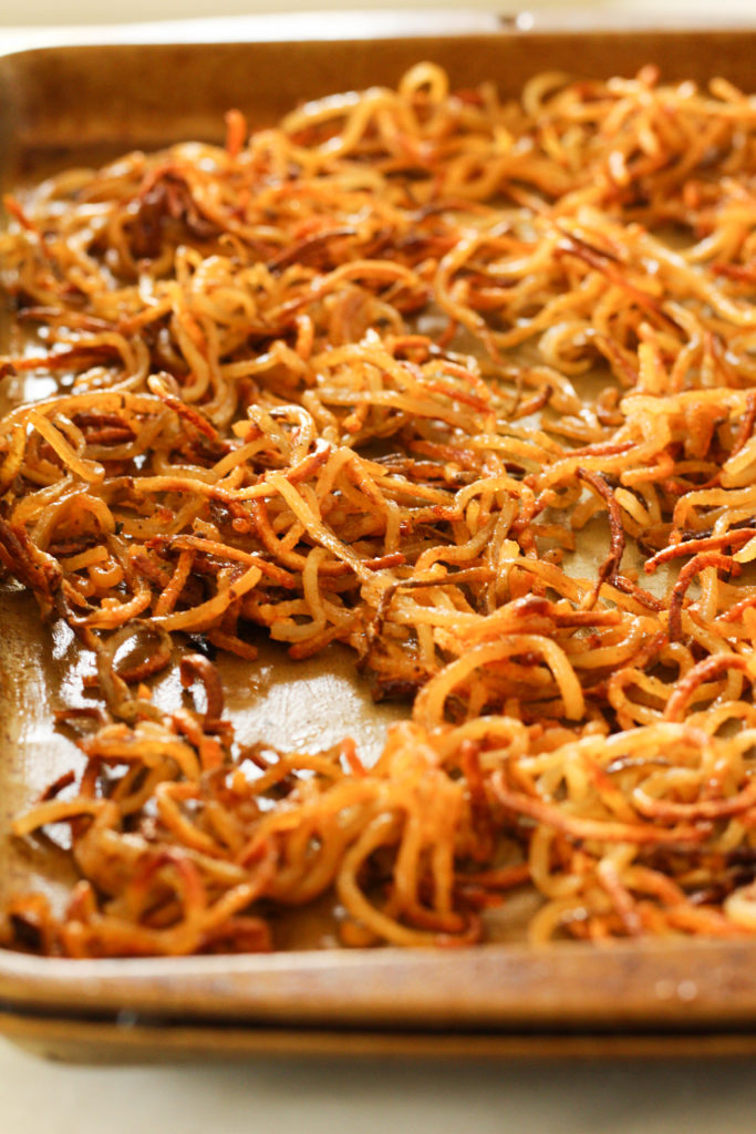 Buffalo shoestring potatoes are the perfect appetizer for your next get together! Spiralized potatoes crisp up quickly in the oven.