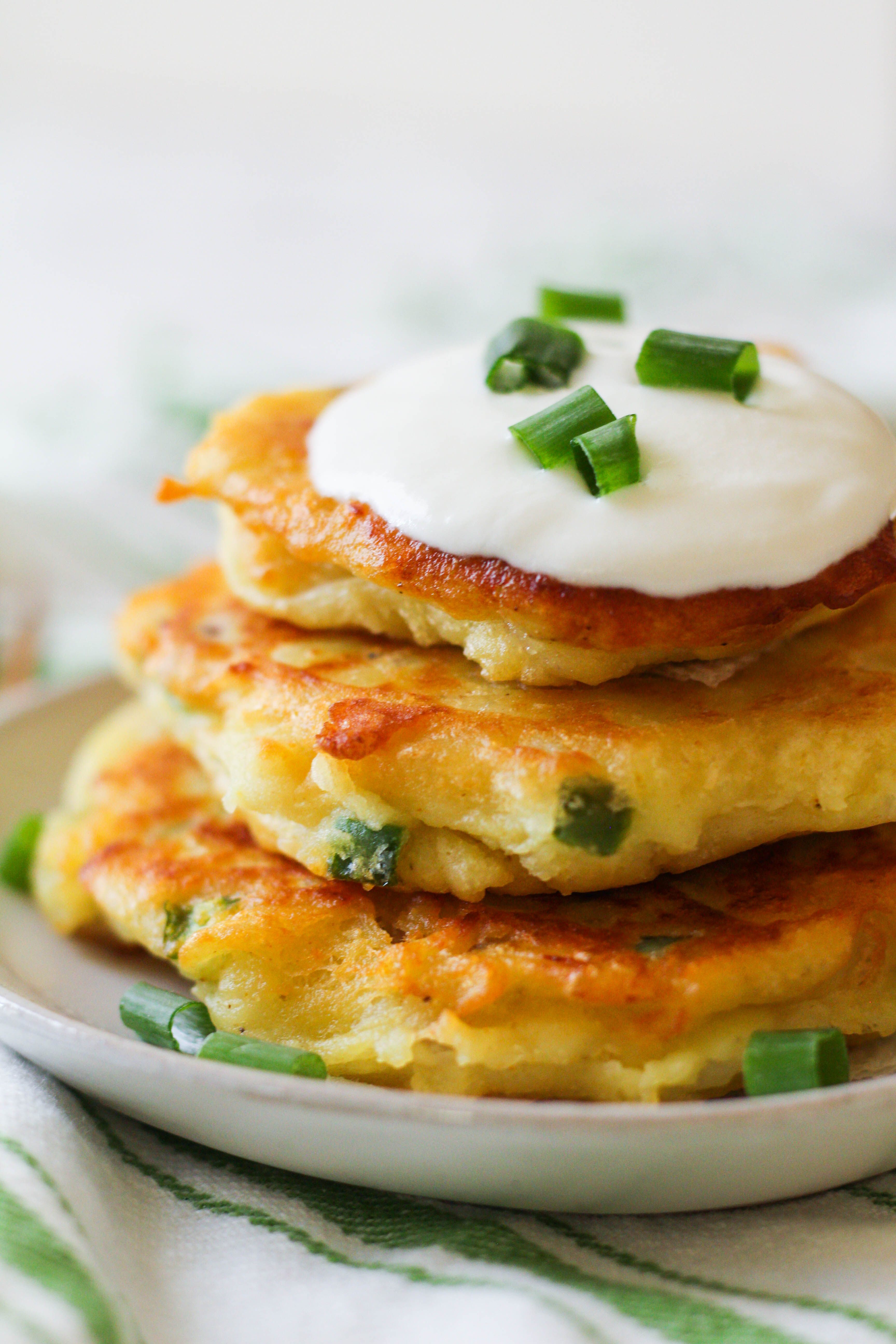 Crispy and golden, these spicy curry potato pancakes are the perfect way to use up leftover mashed potatoes.