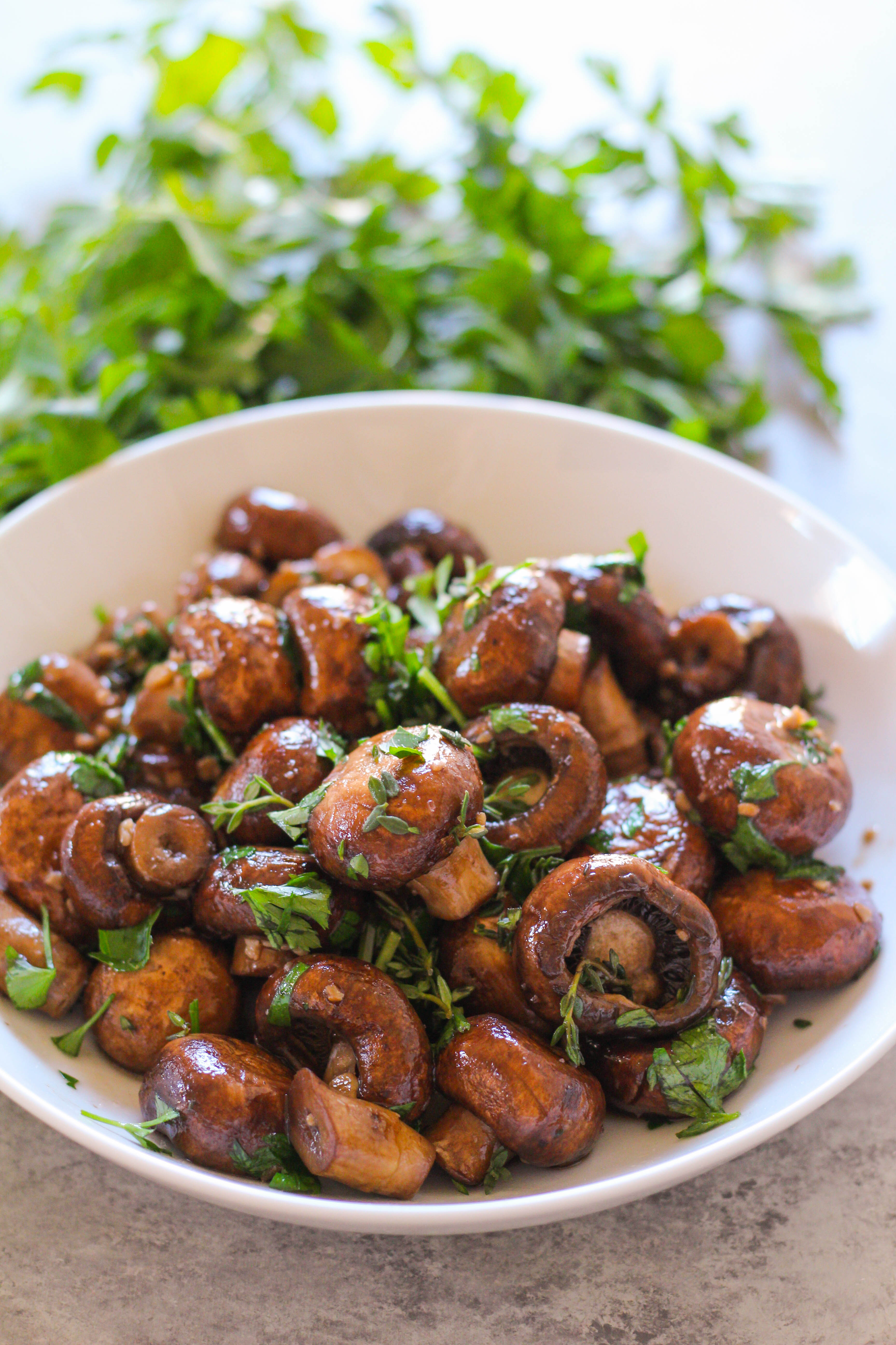 The perfect Spring side dish: savory cremini sauteed mushrooms in buttery ghee and tossed with fresh herbs.