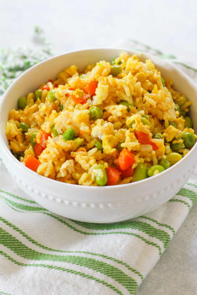 Full of protein and mixed veggies, this easy Scrambled Tofu Fried Rice is a well balanced meal perfect for a weeknight, or a week full of take-to-work lunches!