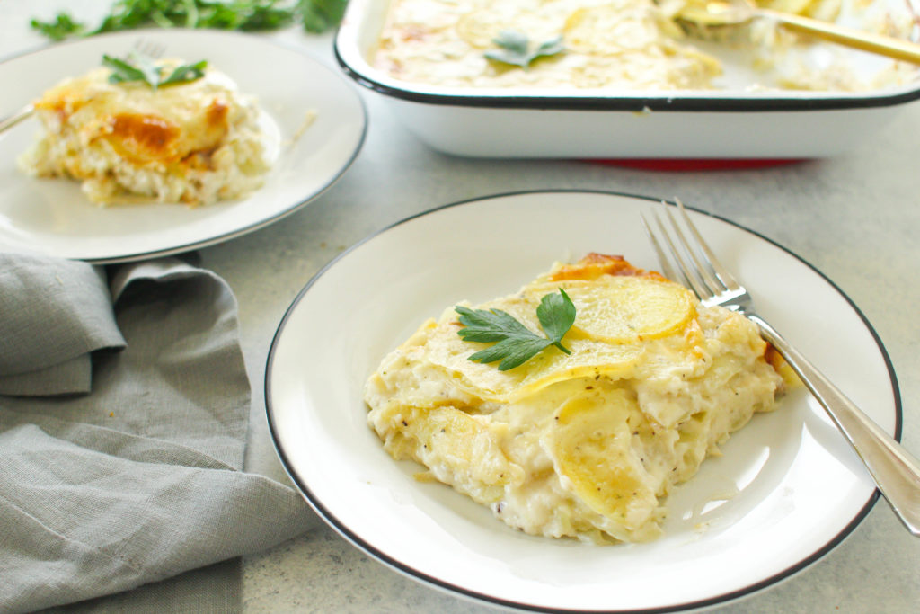 Layers of thinly sliced Yukon gold potatoes covered in a creamy herbed sauce and baked until soft and golden brown. These scalloped potatoes are the perfect comforting side dish to any meal this Fall or Winter season.