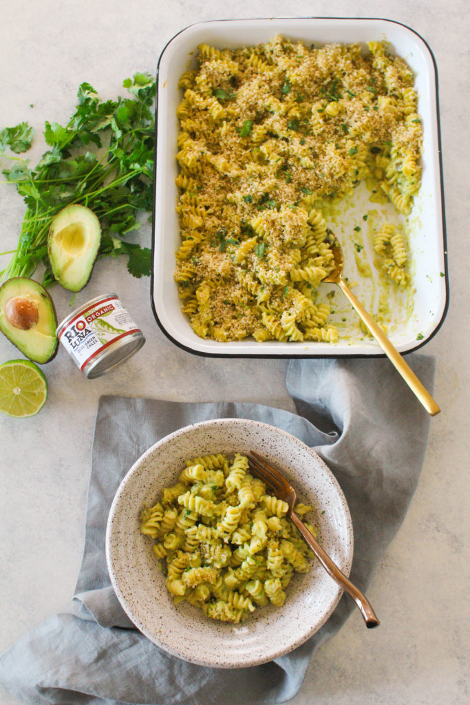 Green chili peppers make their way into a creamy macaroni and cheese made with pepper jack cheese, avocado puree, cilantro and lime. Topped with crispy panko bread crumbs and baked to perfection! This creamy and spicy mac n' cheese is perfect for your holiday party this year.
