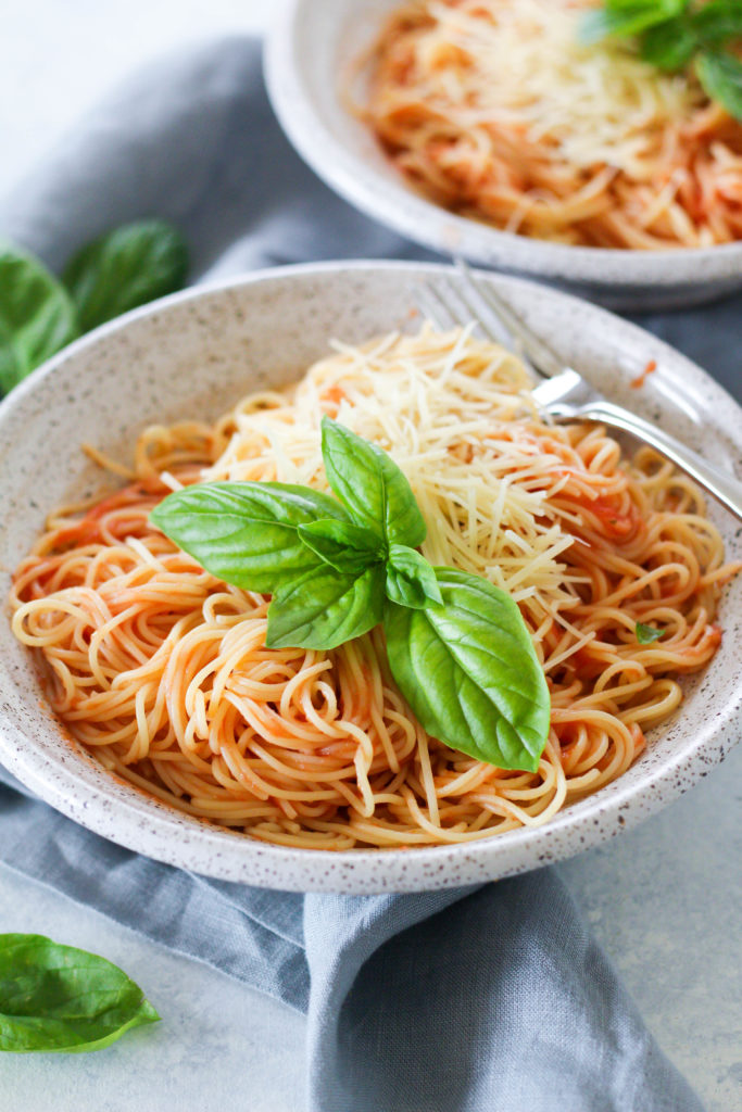 This Capellini Pomodoro comes together in just five minutes, due to it's four ingredient sauce! Simply puree plum tomatoes, olive oil, garlic and salt and toss with hot angel hair pasta.