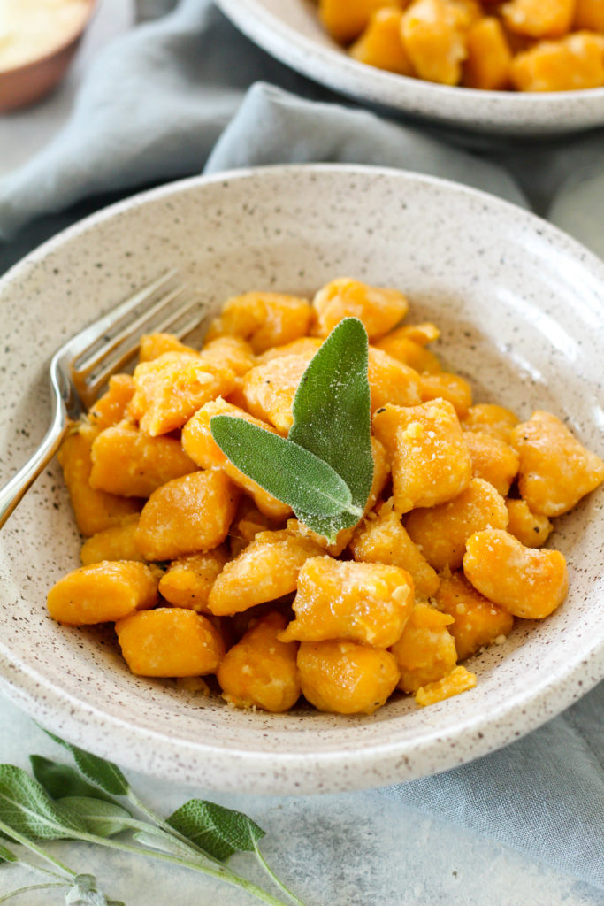 Sweet potato gnocchi are easier to make at home than you think! These pillowy soft and cheesy sweet potato gnocchi are tossed in a sage butter sauce and topped with parmesan.
