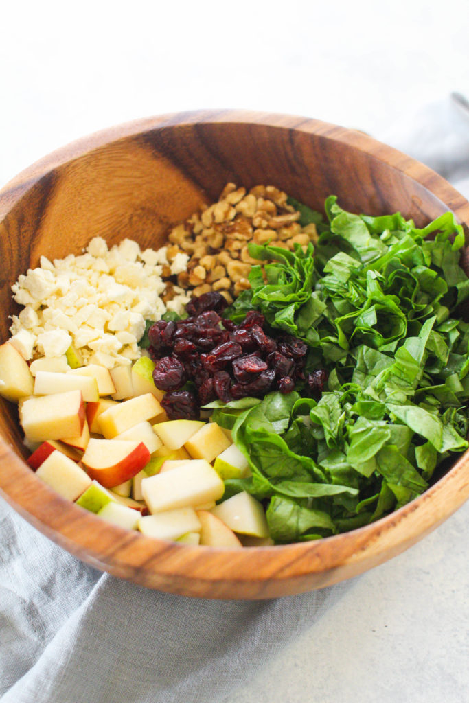 Tender baby spinach, crunchy apples and pears, salty walnuts and briny feta cheese tossed in a sweet and tangy lemon poppy seed dressing. This winter fruit salad is just what you need after a heavy holiday meal!