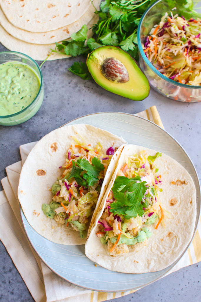 Crispy, garlicky tofu cubes drizzled with a creamy avocado sauce and a handful of zingy crisp slaw. This vegetarian tofu taco dish is sure to please even the tofu skeptics!