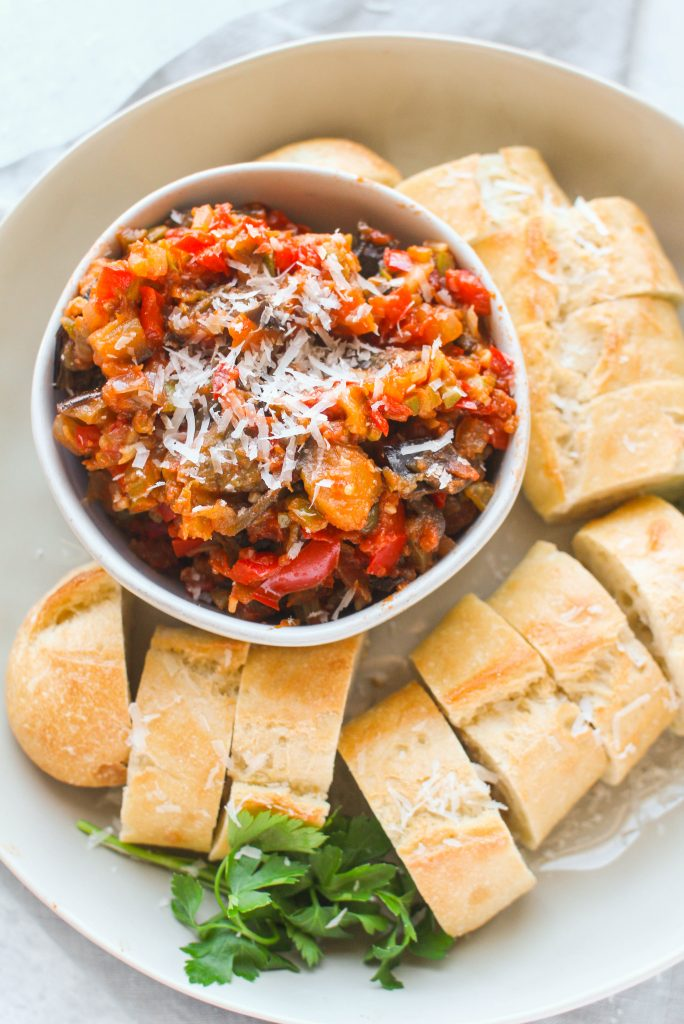 Caponata, a classic Sicilian dish, consists of diced eggplant and veggies in a olive and caper sweet and sour sauce. Eggplant Caponata can be served as-is or on top of sliced crusty bread.