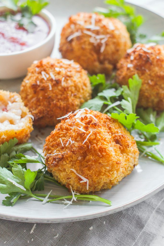 Traditionally made with leftover risotto, Arancini are deep fried risotto balls usually filled with cheese, hearty veggies and/or meat. Today's recipe highlights a creamy crab & parmesan risotto with a panko crust, healthfully fried in an air fryer.