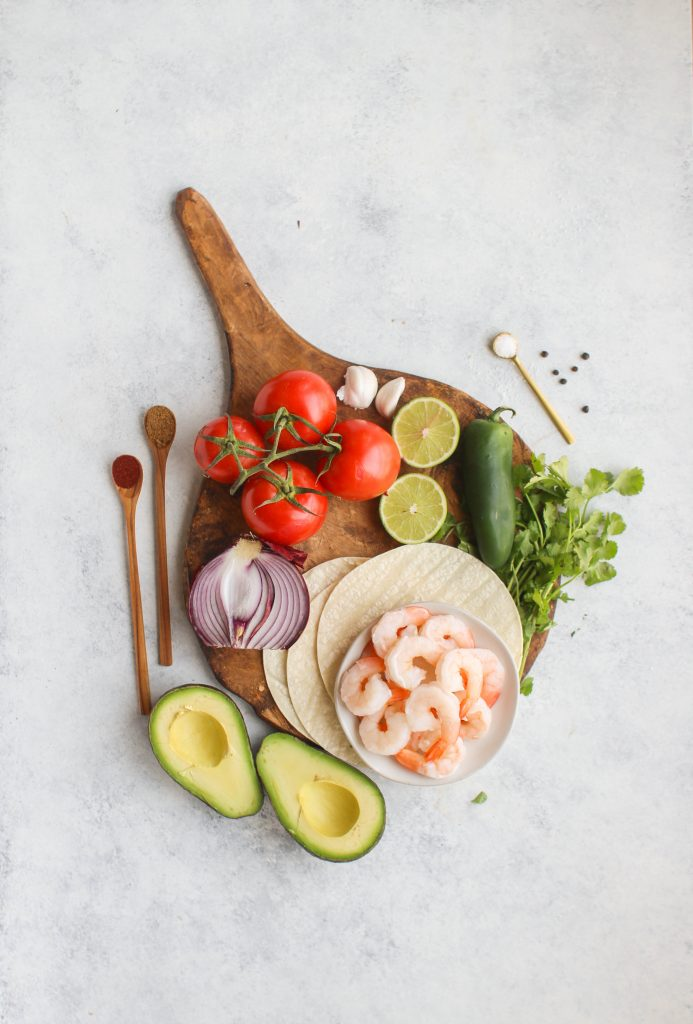 Shrimp marinated in spices and grilled until golden brown top these easy weeknight shrimp tostadas. Don't forget the guacamole and pico de gallo!