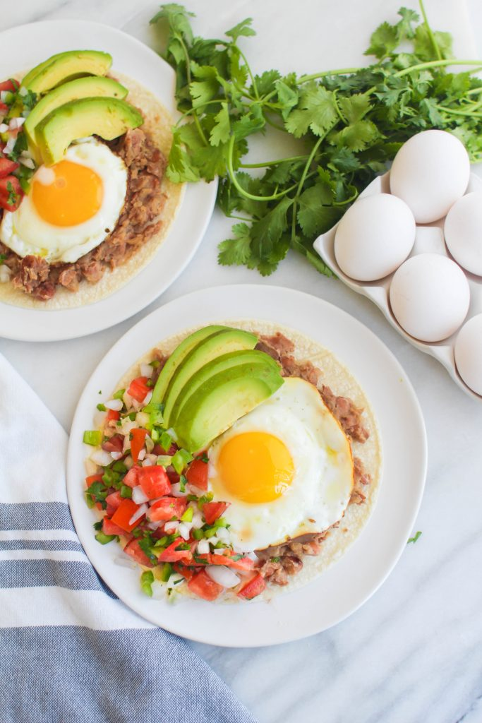 huevos rancheros, corn tortilla, fried egg, pico de gallo, sliced avocado, fresh cilantro