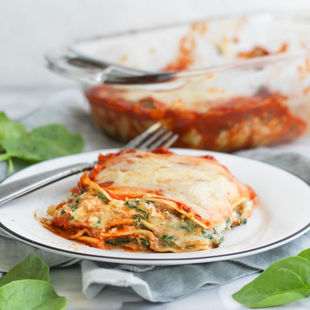 This cheesy spinach lasagna for two is so easy to throw together and tastes delicious! Four layers of ricotta, noodles, sauce, and sauteed spinach.