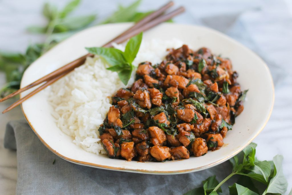 One of the most popular Thai dishes, Thai Basil Chicken (Pad Krapow Gai), is actually very easy to make at home with pantry staples. If you can find Thai basil at your local Asian market, it'll take this recipe to the next level! This dish is spicy with a hint of sweetness and a touch of pepper from the basil.