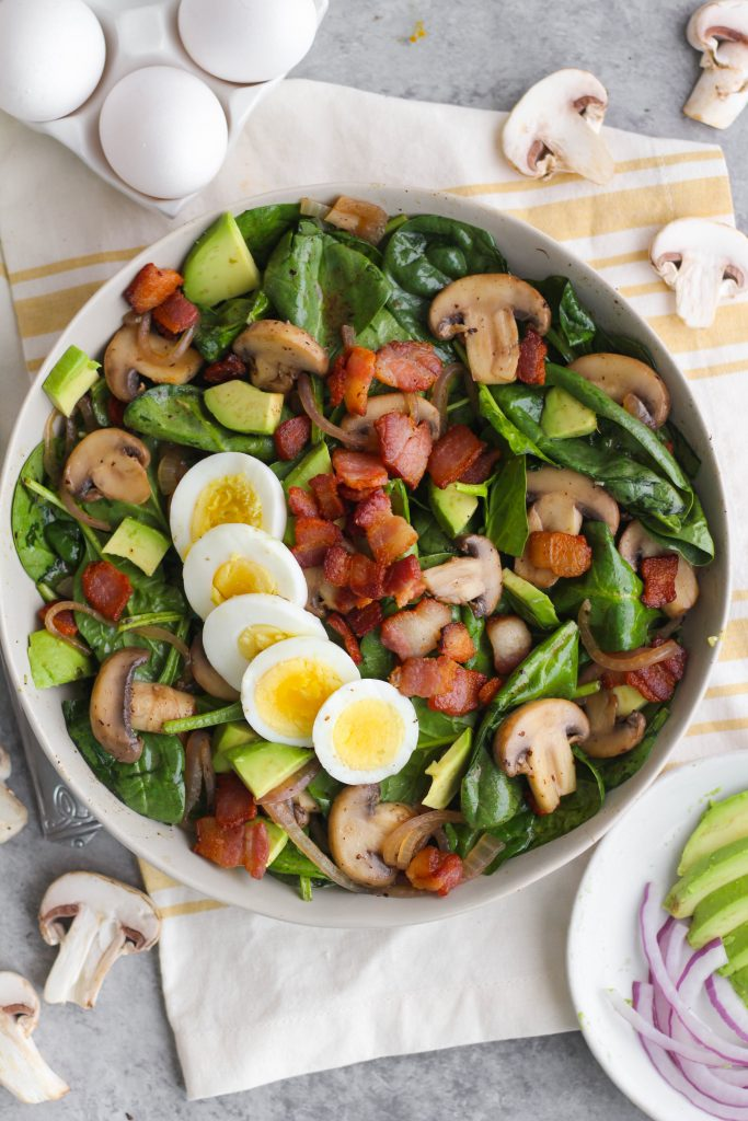 The combination of mushrooms, bacon, avocado, and salty hard-boiled egg is perfect when combined with a vinegar Dijon dressing made right in the skillet! This warm spinach salad is a delicious, easy, and hearty meal sure to fill you up and satisfy your taste buds.