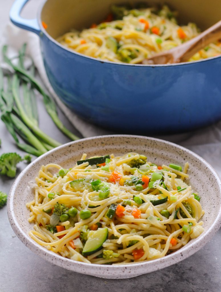 Tender veggies, spaghetti, and a garlicky parmesan sauce make this one-pot spaghetti primavera an easy fix for weeknight dinners.