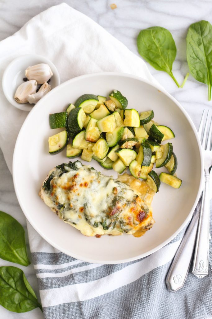 For those nights you want something a little lighter yet still savory and filling! This cheesy spinach chicken bake has two types of cheese and served with a side of roasted zucchini.