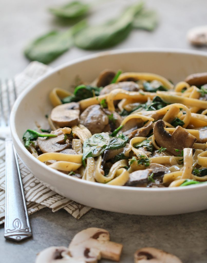 A delicious hearty and healthy twist on the classic stroganoff! This vegan mushroom stroganoff has a creamy coconut milk sauce with plenty of fresh thyme and baby spinach.