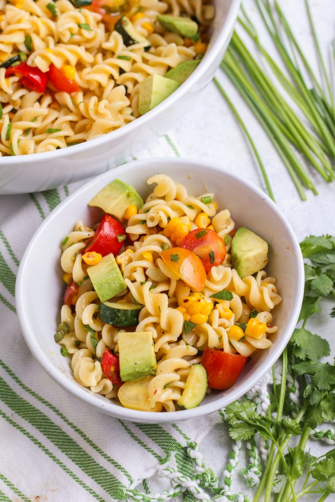 All of your favorite tastes of summer in one salad! Fresh corn, ripe avocado, sweet cherry tomatoes, and a spicy kick from jalapeno.  All tossed with al-dente fusilli pasta and hot lime dressing.