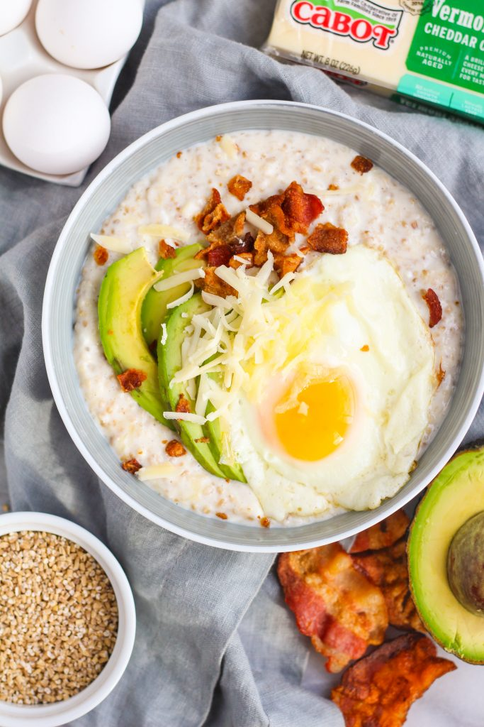 Rethink your oatmeal– it's time to come to the savory side! Try this savory oatmeal with Vermont sharp cheddar, cottage cheese, fried eggs, bacon, avocado, and sriracha!